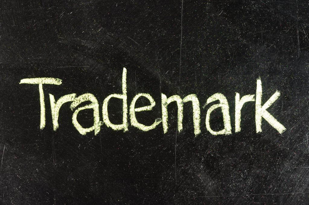 TRADEMARK handwritten with white chalk on a blackboard